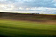 Paddocks Prints - Blurred landscape seen from a speeding car Print by Sami Sarkis