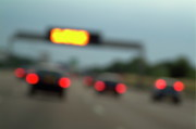 Locations Framed Prints - Blurred tail lights of cars travelling on a highway Framed Print by Sami Sarkis