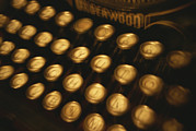 Typewriters Photos - Blurred View Of The Keys Of An Old by Todd Gipstein