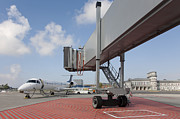 Tallinn Airport Photo Posters - Boarding Bridge Leading to a Parked Plane Poster by Jaak Nilson