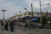 Local Posters - Boardwalk At Coney Island On A Cloudy Poster by Todd Gipstein