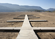 Rimrock Posters - Boat Dock on Dry Lakebed Poster by Paul Edmondson