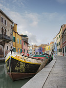 Apartment Framed Prints - Boat in a Canal Lined With Colorful Homes Framed Print by Andersen Ross