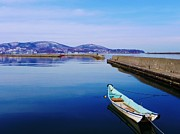 Stationary Photos - Boat In Blue Harbour At Otaru Chikko In Hokkaido by Anne McKechnie