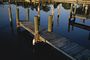 Etc. Photos - Boat Slips At A Marina On A Calm by Raul Touzon