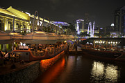Night Framed Prints - Boats moored on water at Clarke Quay in Singapore  Framed Print by Ashish Agarwal
