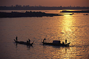 River Scenes Posters - Boats Silhouetted On The Mekong River Poster by Steve Raymer