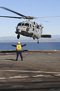 60s Photos - Boatswain's Mate Directs An Mh-60s by Stocktrek Images