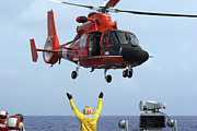 Search And Rescue Photos - Boatswain Mate Directs A Hh-65a Dolphin by Stocktrek Images