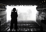 Boats On Water Photo Posters - Boatswains Mate Directs A Landing Craft Poster by Stocktrek Images