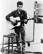 Historical Photo Posters - Bob Dylan B. 1941 Playing Guitar Poster by Everett