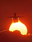 Boeing 737 Photos - Boeing 737 Taking Off At Sunset by David Nunuk