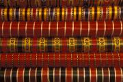Shiny Fabric Prints - Bolts Of Silk In A Shop In The Grand Print by Richard Nowitz