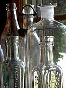 Glass Bottle Framed Prints - Bottle Necks Framed Print by Richard Mansfield