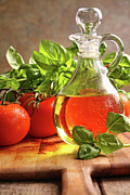 Bottle Photos - Bottle of olive oil with vegetables by Sandra Cunningham