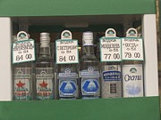 Wines Photos - Bottles Of Vodka Sold From A Street by Richard Nowitz