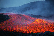 Fiery Red Posters - Boulder Rolling In Lava Flow At Dusk Poster by Richard Roscoe