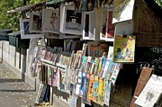 Ile De France Framed Prints - Bouquiniste book seller at quays of Seine Paris Framed Print by Bernard Jaubert