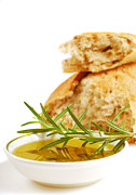 Olives Photo Posters - Bowl of olive oil with crusty bread and rosemary Poster by David Smith