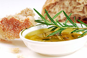 Olives Photo Posters - Bowl of olive oil with rosemary and bread Poster by David Smith