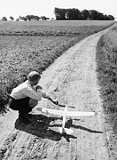 10:11 Prints - Boy (10-12) With Model Plane On Dirt Path (b&w) Print by Hulton Archive