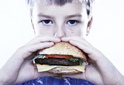 Hunger Posters - Boy Eating A Burger Poster by Kevin Curtis