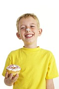 Donut Posters - Boy Eating A Doughnut Poster by Ian Boddy