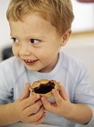 Home Made Food Photos - Boy Eating A Jam Tart by Ian Boddy