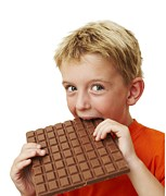 Consume Framed Prints - Boy Eating Chocolate Framed Print by Ian Boddy