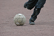 Kicks Prints - Boy playing soccer with a ball Print by Matthias Hauser