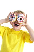 Doughnuts Framed Prints - Boy Playing With Doughnuts Framed Print by Ian Boddy