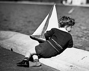 Toy Boat Framed Prints - Boy Playing With Toy Sailboat Framed Print by George Marks