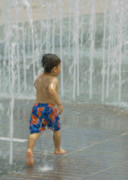 Boy Running In The Water Print by Robert  Suggs