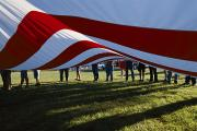 Spencer Prints - Boy Scouts Lift A Huge American Flag Print by Randy Olson