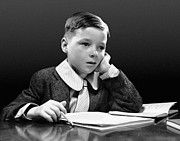 Desk Photo Prints - Boy Sitting At Desk W/book Print by George Marks