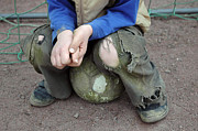 Sports Photos - Boy sitting on ball - torn trousers by Matthias Hauser