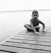 Legs Crossed Posters - Boy Sitting On Dock Poster by Michelle Quance
