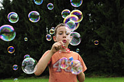 Soap Bubbles Framed Prints - Boy with colorful bubbles Framed Print by Matthias Hauser