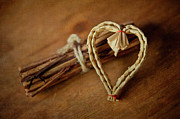 Love Letter Prints - Braided Wicker Heart On Small Bundled Wood Print by Alexandre Fundone