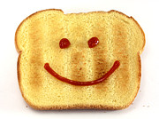 Snack Posters - Bread with happy face Poster by Blink Images