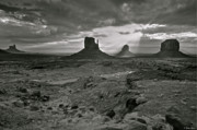 Breaking Light At Monument Valley - Black And White Print by Brian Stamm