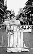 Brides Dress Framed Prints - Bride on the Barricade on Bourbon St NOLA Framed Print by Kathleen K Parker