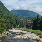 Fukushima Posters - Bridge Over Lush River Gorge In Mountains Poster by Ippei Naoi