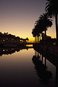 Buildings At Sunset Prints - Bridge Over Waterway at Sunset Print by Thom Gourley/Flatbread Images, LLC