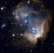 Hubble Space Telescope Views Posters - Bright Blue Newborn Stars Blast A Hole Poster by ESA and nASA