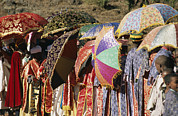 Religious Celebrations Prints - Brightly Colored Umbrellas And Robes Print by Michael S. Lewis