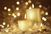 Background Art - Brightly lit candles in wet snow by Sandra Cunningham