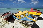 Antilles Prints - Brightly Painted Fishing Boats Aruba Print by George Oze