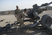 Artillery Metal Prints - British Soldiers Test Fire A Howitzer Metal Print by Andrew Chittock