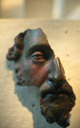 Face Sculpture Posters - Bronze fragment of a human face Poster by Carl Purcell